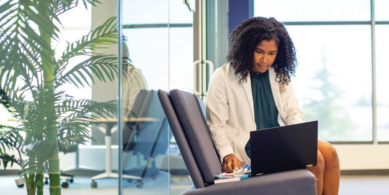 PharmD student with laptop outside quiet study area