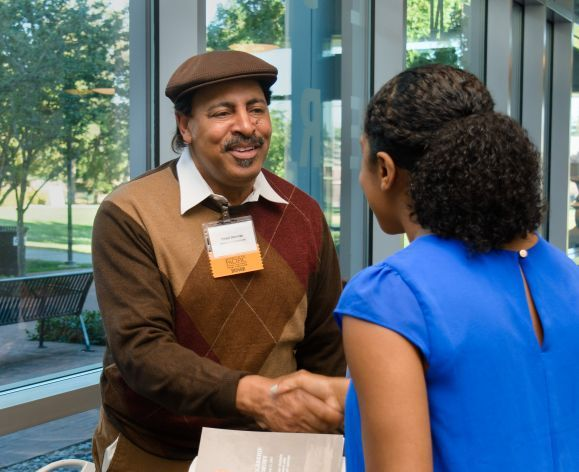 Donor shakes hand with student at the annual Pharmacy Scholarship Ceremony
